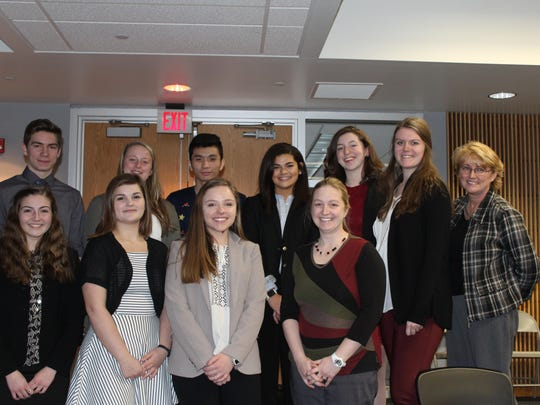 St. Thomas More mock trial students, from left, front row, Giulia Randazzo, Madison Murrian, Haley Davidson and advisor Casey Cashdollar; back row, Zac Mazuchowski, Ryan Anderson, Depeng Jason Chen, Sophia Stafford, Logan Hughes, Elise Conlin and advisor Nancy Knapp.