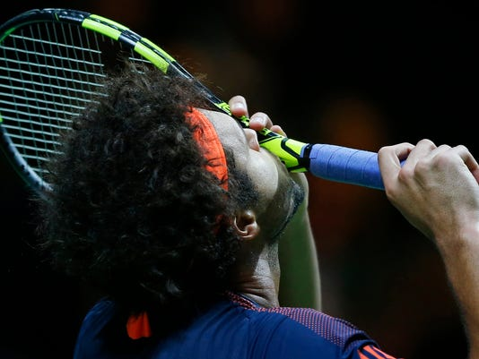 France's Jo-Wilfried Tsonga kisses his racket in his match against Belgium's David Goffin in the men's singles final of the ABN AMRO world tennis tournament at the Ahoy stadium in Rotterdam, Netherlands, Sunday, Feb. 19, 2017. (AP Photo/Peter Dejong)
