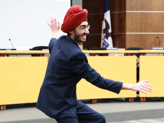 Valley High School junior JJ Kapur performs a Bollywood dance to begin his speech before the West Des Moines school board.