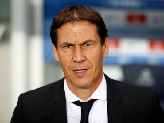 FILE - This is a Sunday, Oct. 23, 2016 file photo of Marseille's coach Rudi Garcia as he ooks on during their French League One soccer match between PSG and Marseille at the Parc des Princes stadium in Paris. Marseille owner Frank McCourt, the former owner of baseball's Los Angeles Dodgers, pledged to make the club competitive on all fronts by investing 200 million euros ($210 million) over four years and immediately hired successful French coach Rudi Garcia. (AP Photo/Francois Mori, File)