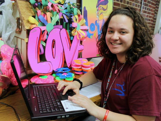 "St. Elizabeth sophomore Mary Nottingham is creating a catalog of items for St. E's ""Feelin' GroovE"" auction."