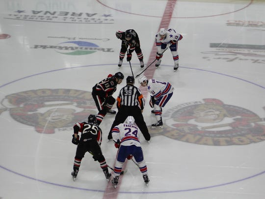 The Binghamton Senators line up for a faceoff against the visiting Rochester Americans on Saturday night at Floyd L. Maines Veterans Memorial Arena. The B-Sens lost, 5-4.