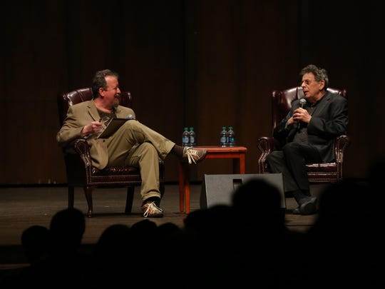"Tallahassee Democrat arts writer and columnist Mark Hinson, left, interviews composer Philip Glass during ""An Evening With Philip Glass"" this week at Florida State."