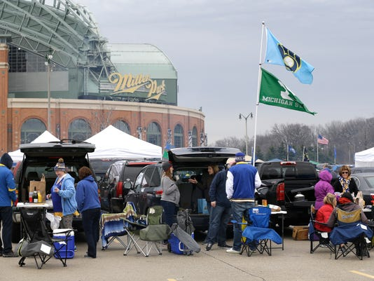 Fans tailgate outside Miller Park before an opening day baseball game between the Colorado Rockies and Milwaukee Brewers Monday, April 3, 2017, in Milwaukee. (AP Photo/Jeffrey Phelps)