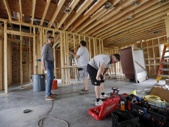 Zach Tyson, left, owner of Tyson Construction, talks to electricians in a home he is constructing in Destrahan, La. General contractors and other small businesses in the remodeling industry can look forward to strong growth in the coming years, but the big force behind that business may be surprising: baby boomers. Tyson estimates that between 30 percent and 40 percent of his revenue is coming from boomer renovations, up from 15 percent to 20 percent five years ago.