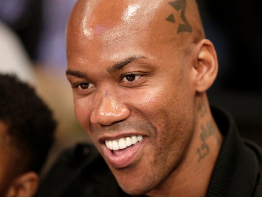 """In this April 9, 2017, photo, former NBA All Star Stephon Marbury attends an NBA basketball game between the New York Knicks and the Toronto Raptors in New York. Marbury's agent said Tuesday, April 25, 2017, that they are in talks with several clubs in China after he parted ways with the Beijing Ducks at the weekend. Marbury """"will definitely play one more year,"""" Wang Meng told The Associated Press. Marbury, 40, helped the Beijing Ducks secure three China Basketball Association championship wins after joining them in 2011 following a roller-coaster NBA career. (AP Photo/Seth Wenig)"""