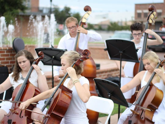 Chamber music sets the upscale tone for an Evening in White fundraiser.