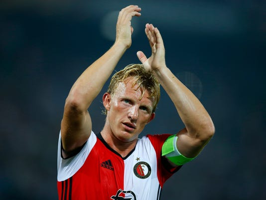 In this Sept. 15m 2016 file photo Feyenoord's team captain Dirk Kuyt applauds the supporters at the end of the Group A Europa League match between Feyenoord and Manchester United at the De Kuip stadium in Rotterdam, Netherlands. Veteran captain Dirk Kuyt scored a hat trick Sunday May 14, 2017, as Feyenoord beat Heracles Almelo 3-1 to win its 15th Dutch Eredivisie title and the first in 18 long years for its fervent fans. Kuyt returned to Feyenoord in the twilight of his career saying he wanted to lead the team to the Dutch championship and scored his 100th goal for the club in the first minute to settle nerves throughout Rotterdam. (AP Photo/Peter Dejong)