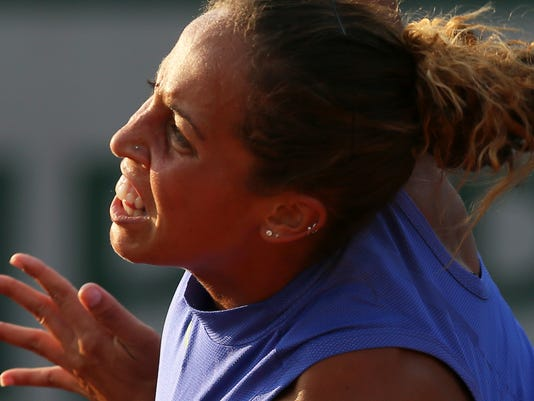 Madison Keys of the U.S. plays a shot against Croatia's Petra Martic during their second round match of the French Open tennis tournament at the Roland Garros stadium, in Paris, France. Thursday, June 1, 2017. (AP Photo/David Vincent)