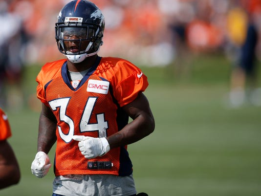 FILE--In this Friday, July 29, 2016, file photograph, Denver Broncos safety Will Parks takes part in drills during the team's NFL football training camp in Englewood, Colo. Parks, the Broncos backup safety, said on Monday, June 5, 2017, that he meant no harm toward quarterback Paxton Lynch when Parks used Snapchat to show two video clips last week of Lynch throwing incomplete passes during minicamp. (AP Photo/David Zalubowski, file)