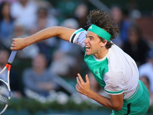 Austria's Dominic Thiem serves to Spain's Rafael Nadal during their semifinal match of the French Open tennis tournament at the Roland Garros stadium, Friday, June 9, 2017 in Paris. (AP Photo/David Vincent)