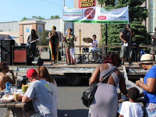 "Reggae band The Burnsiders perform Bob Marley's classic ""No Woman, No Cry"" during the food truck festival."