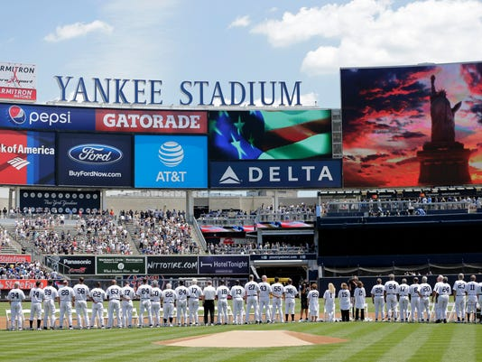 Former New York Yankees players stand for the national anthem during Old-Timers' Day at Yankee Stadium, Sunday, June 25, 2017, in New York. (AP Photo/Seth Wenig)