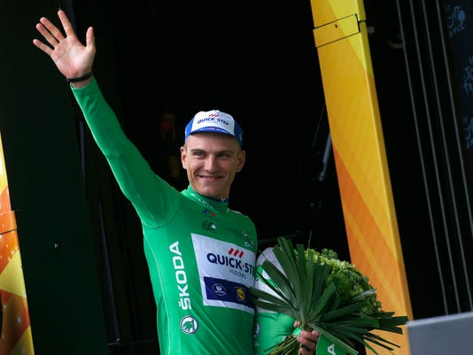 Stage winner Marcel Kittel of Germany, wearing the best sprinter's green jersey, celebrates on the podium after the second stage of the Tour de France cycling race over 203.5 kilometers (126.5 miles) with start in Dusseldorf, Germany, and finish in Liege, Belgium, Sunday, July 2, 2017. (AP Photo/Peter Dejong)