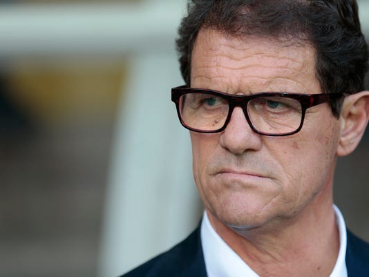 FILE - In this June 14, 2015 file photo, Russia's coach Fabio Capello watches his players during the Euro 2016 qualifying soccer match between Russia and Austria, in Moscow, Russia. Capello, winner of the UEFA Champions League in 1994 and who also led the national teams of England and Russia to the 2010 and 2014 World Cups, was appointed as head coach of Jiangsu Suning in June. (AP Photo/Ivan Sekretarev, File)