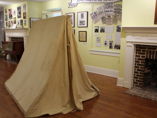 A tent stands in the middle of the room dedicated to several American wars.