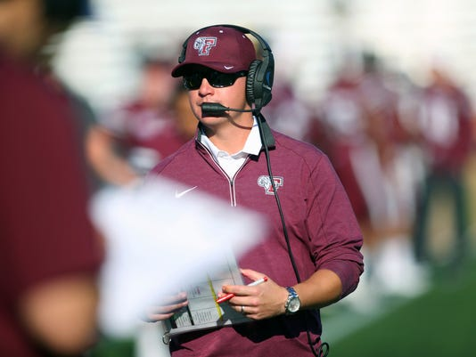 In this Oct. 15, 2016, photo provided by Fordham Athletics, Fordham football coach Andrew Briener stands on the sideline during the NCAA college football team's game against Yale in New York. Breiner, considered one of the bright young offensive minds in college coaching, let the AP sit in on a summer game-planning meeting, and then explained how he and his staff do it during the season. (Vincent Dusovic/Fordham Athletics vs AP)