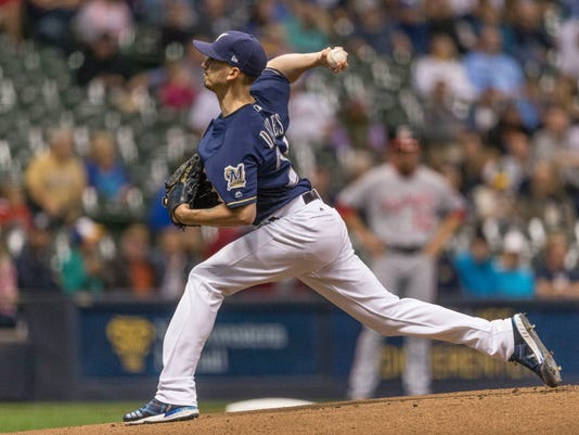 Milwaukee Brewers' Zach Davies pitches to a Washington Nationals batter during the first inning of a baseball game Thursday, Aug. 31, 2017, in Milwaukee. (AP Photo/Tom Lynn)