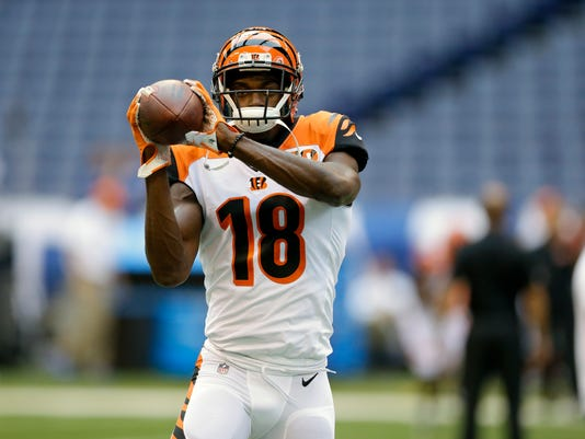 FILE - In this Thursday, Aug. 31, 2017, file photo, Cincinnati Bengals wide receiver A.J. Green warms up before a preseason NFL football game against the Indianapolis Colts in Indianapolis. The Bengals first regular season game is scheduled against the Baltimore Ravens on Sunday, Sept. 10. (AP Photo/Michael Conroy, File)