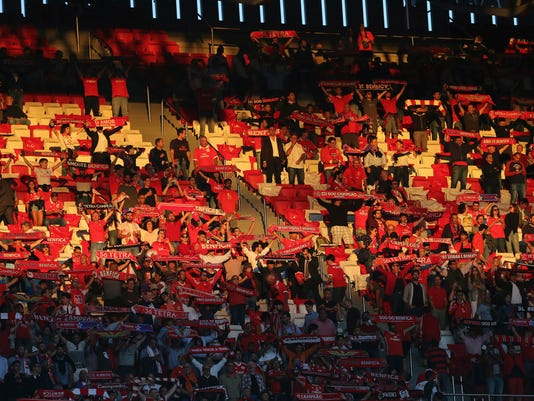 Fans of Benfica hold up their scarfs during the Champions League group A soccer match between SL Benfica and CSKA Moscow at the Luz stadium in Lisbon, Tuesday, Sept. 12, 2017. (AP Photo/Armando Franca)