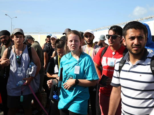 Students from the American University of the Caribbean School of Medicine: AUC, wait to be evacuated on September 11 in Philipsburg, St. Maarten. The Caribbean island sustained extensive damage from Hurricane Irma.