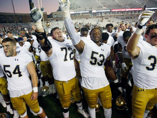 Notre Dame's Robert Hainsey (72) and Khalid Kareem (53) celebrate with teammates after defeating Boston College 49-20 during an NCAA college football game in Boston, Saturday, Sept. 16, 2017.(AP Photo/Michael Dwyer)