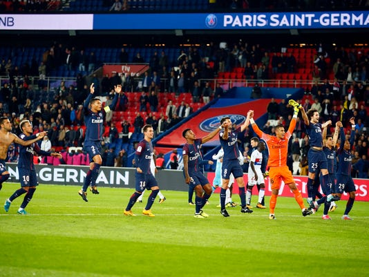 Paris Saint Germain's celebrate their 2-0 after their French League One soccer match between PSG and Olympique Lyon at the Parc des Princes stadium in Paris, France, Sunday, Sept. 17, 2016. (AP Photo/Francois Mori)