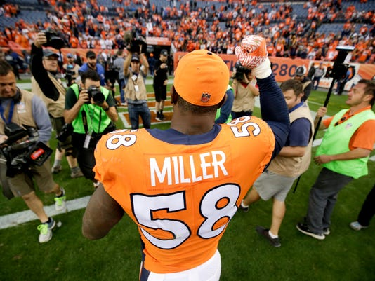 Denver Broncos outside linebacker Von Miller celebrates as he leaves the field after an NFL football game against the Oakland Raiders, Sunday, Oct. 1, 2017, in Denver. (AP Photo/Jack Dempsey)