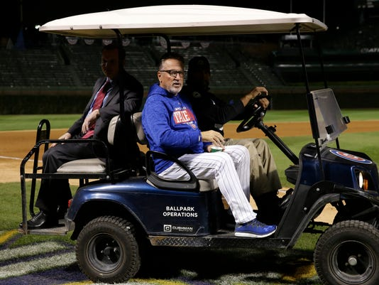 Chicago Cubs manager Joe Maddon rides on a cart after Game 5 of baseball's National League Championship Series against the Los Angeles Dodgers, Thursday, Oct. 19, 2017, in Chicago. The Dodgers won 11-1 to win the series and advance to the World Series. (AP Photo/Nam Y. Huh)