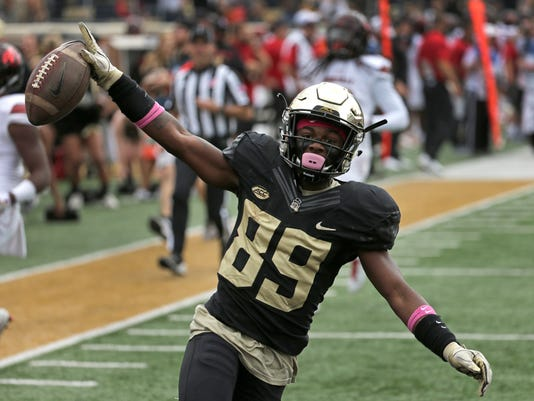 Wake Forest's Greg Dortch (89) celebrates a touchdown against Louisville during the first half of an NCAA college football game in Winston-Salem, N.C., Saturday, Oct. 28, 2017. (AP Photo/Chuck Burton)