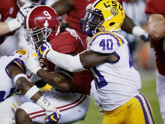 Alabama running back Bo Scarbrough is tackled by LSU linebacker Devin White during the first half of an NCAA college football game, Saturday, Nov. 4, 2017, in Tuscaloosa, Ala. (AP Photo/Brynn Anderson)