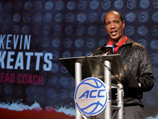 FILE - In this Oct. 25, 2017, file photo, North Carolina State head coach Kevin Keatts answers a question during the Atlantic Coast Conference men's NCAA college basketball media day in Charlotte, N.C. Keatts is eager to see what his Wolfpack players have learned as they prepare for his debut on the sideline Friday against VMI. (AP Photo/Chuck Burton, File)