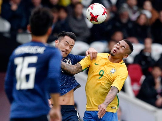 Brazil's Gabriel Jesus, right, challenges the ball with Japan's Maya Yoshida during their international friendly soccer match Brazil against Japan at the Pierre Mauroy stadium in Lille, northern France, Friday, Nov. 10, 2017. (AP Photo/Michel Spingler)