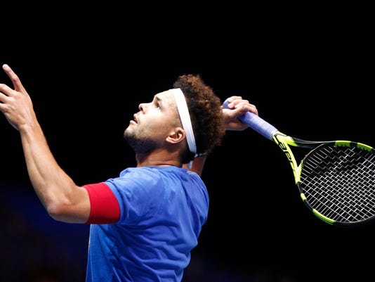 Wilfried Tsonga of France returns a ball during a training session at the Pierre Mauroy stadium in Lille, northern France, Wednesday, Nov. 22, 2017. France will face Belgium in the Davis Cup final starting next Friday. (AP Photo/Michel Spingler)