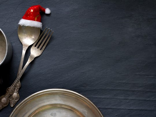 Christmas cutlery on the table abstract food background