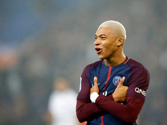 PSG's Kylian Mbappe reacts after scoring a goal during the French League One soccer match between Paris Saint Germain and Caen, at the Parc des Princes stadium in Paris, France, Wednesday, Dec. 20, 2017. (AP Photo/Francois Mori)