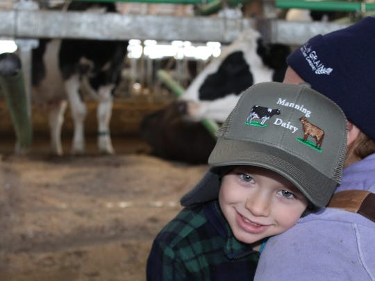 Three generations of family members work alongside each other at the Manning Farm, and the fourth generation, Ryland Howrigan, above, and his sister Regan provide some comic relief.