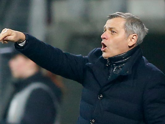 FILE - This is a Thursday, Feb. 16, 2017 file photo of Lyon's coach Bruno Genesio gestures during the round of 32, first leg, Europa League soccer match between AZ and Lyon at AZ stadium in Alkmaar, Netherlands. Three defeats and a draw in the past four games, with 10 goals conceded, has seriously dented Lyon's bid for a top-three finish and a place in next season's Champions League. (AP Photo/Peter Dejong/File)