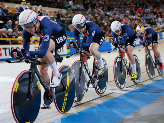 Gold medalist team U.S.A. with Jennifer Valente, Kelly Catlin, Chloe Dygert and Kimberly Geist competes in the women's team pursuit final at the World Championships Track Cycling in Apeldoorn, eastern Netherlands, Netherlands, Thursday, March 1, 2018. (AP Photo/Peter Dejong)