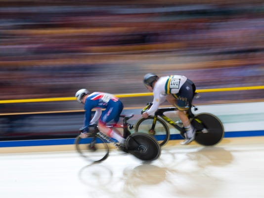 World champion Matthew Glaetzer of Australia, right, beats silver medalist Jack Carlin of Britain, left, in the final of the men's sprint at the World Championships Track Cycling in Apeldoorn, eastern Netherlands, Netherlands, Saturday, March 3, 2018. (AP Photo/Peter Dejong)