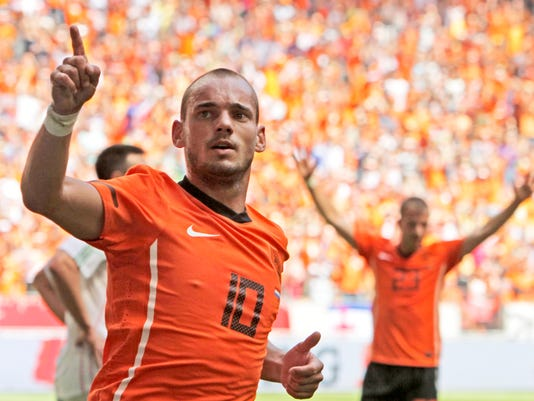 FILE - In this Saturday June 5, 2010 file photo Wesley Sneijder of The Netherlands celebrates scoring during the friendly soccer match Netherlands versus Hungary at ArenA stadium in Amsterdam, Netherlands. Midfielder Wesley Sneijder is retiring from international football after 15 years and a record 133 appearances for the Netherlands. The Dutch football association announced the retirement Sunday after new coach Ronald Koeman visited 33-year-old Sneijder in Qatar, where he plays for Al Gharafa. (AP Photo/Peter Dejong)