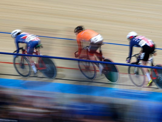 Elinor Barker of Britain leads before World champion Kirsten Wild of The Netherlands, center, and Jennifer Valente of the U.S. in the women's points race at the World Championships Track Cycling in Apeldoorn, eastern Netherlands, Netherlands, Sunday, March 4, 2018. (AP Photo/Peter Dejong)