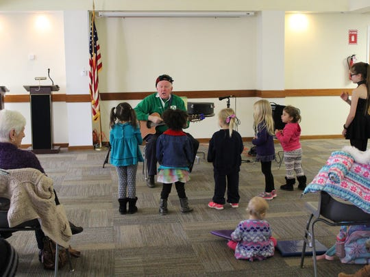 "Joseph ""Grandfather Joe"" McGonigle performs for a captivated crowd March 14 during the Mays Landing Branch's annual St. Paddy's Day Sing-Along."