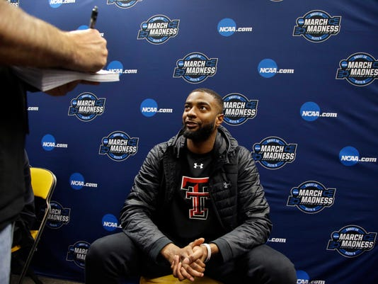 Texas Tech guard Niem Stevenson speaks to a reporter at the NCAA men's college basketball tournament, Saturday, March 24, 2018, in Boston. Texas Tech faces Villanova in a regional final on Sunday. (AP Photo/Elise Amendola)