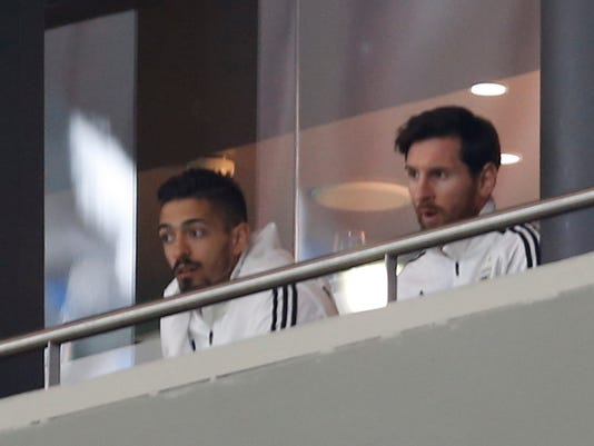 Lionel Messi, right, watches the international friendly soccer match between Spain and Argentina at the Wanda Metropolitano stadium in Madrid, Spain, Tuesday, March 27, 2018. (AP Photo/Francisco Seco)