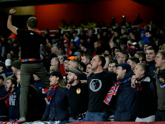 CSKA's fans shout during the Europa League quarterfinal, first leg soccer match between Arsenal and CSKA Moscow at the Emirates stadium in London Thursday, April 5, 2018. (AP Photo/Tim Ireland)