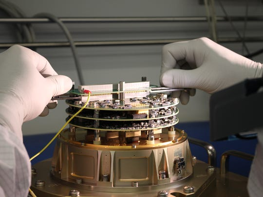 A technician works on one of TESS' four cameras, which were developed at the MIT Kavli Institute for Astrophysics and Space Research, Cambridge, Massachusetts. The cameras record light from stars, whose dimming may indicate the presence of a transiting exoplanet. The institute points out that a computer aboard the spacecraft will process the data before they are radioed to Earth.
