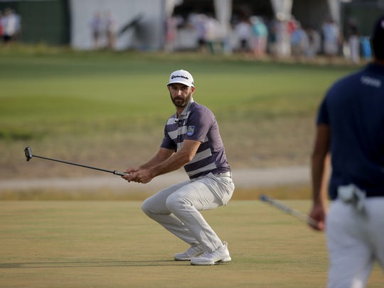 Dustin Johnson reacts after missing a putt on the 15th green during the third round of the U.S. Open Golf Championship, Saturday, June 16, 2018, in Southampton, N.Y. (AP Photo/Seth Wenig)