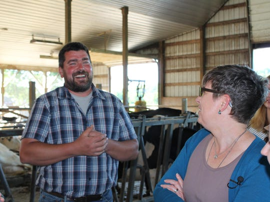 Sixth-generation dairy farmer Ransom Conant leads community members on a tour of his 170-year-old farm.