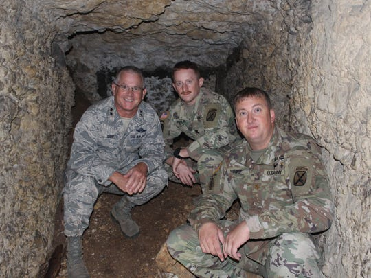 Maj. Gen. Steven Cray, Capt. Joe Phelan, and Maj. Zachariah Fike, all of the Vermont National Guard, pose for a picture in one of the caves at the Apremont Forest near the Bois Brule where Cpl. Leonard Lord of Swnaton was killed in action. Soldiers dug out these caves for cover from artillery fire.